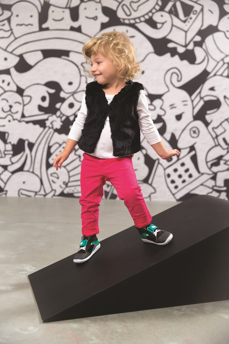 active-girl-posing-with-bobux-shoes