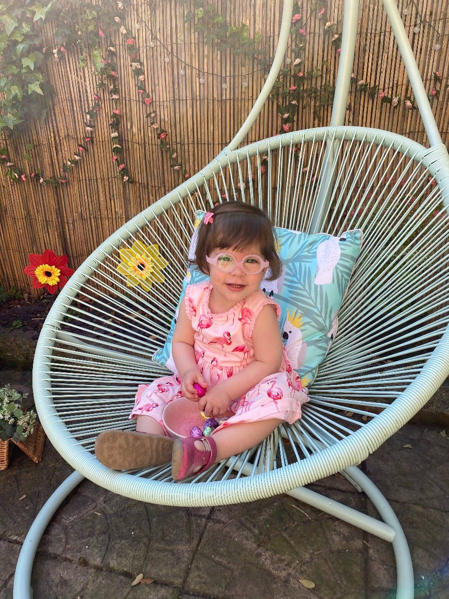Clara girl sitting on chair