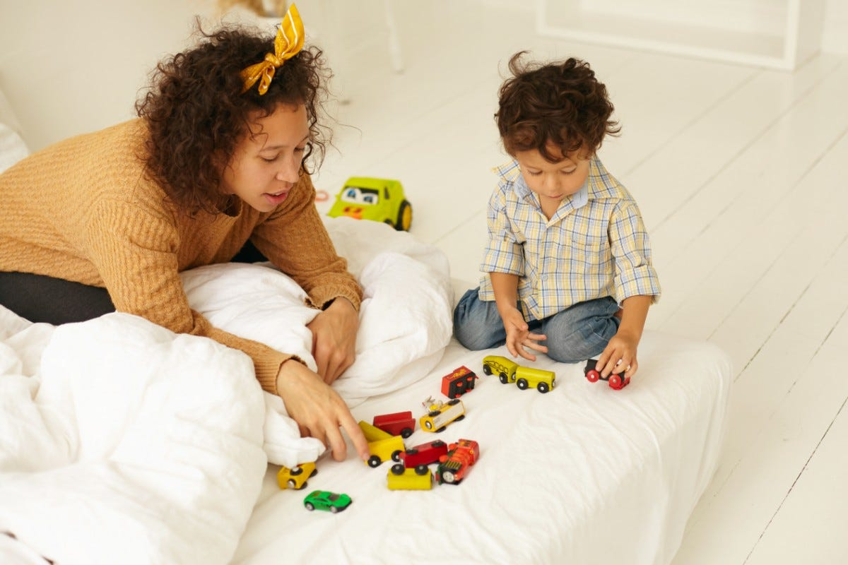 mother and son playing indoors