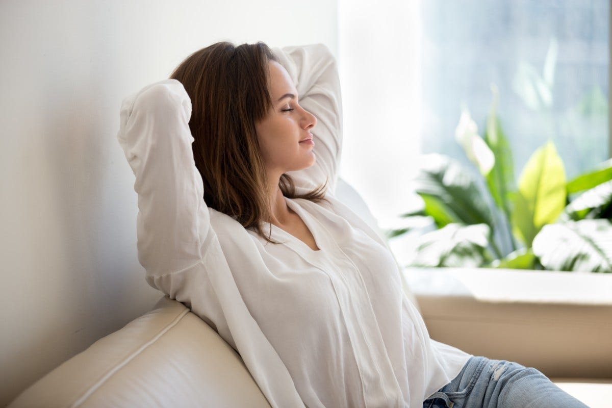 relaxed calm woman breathing at home