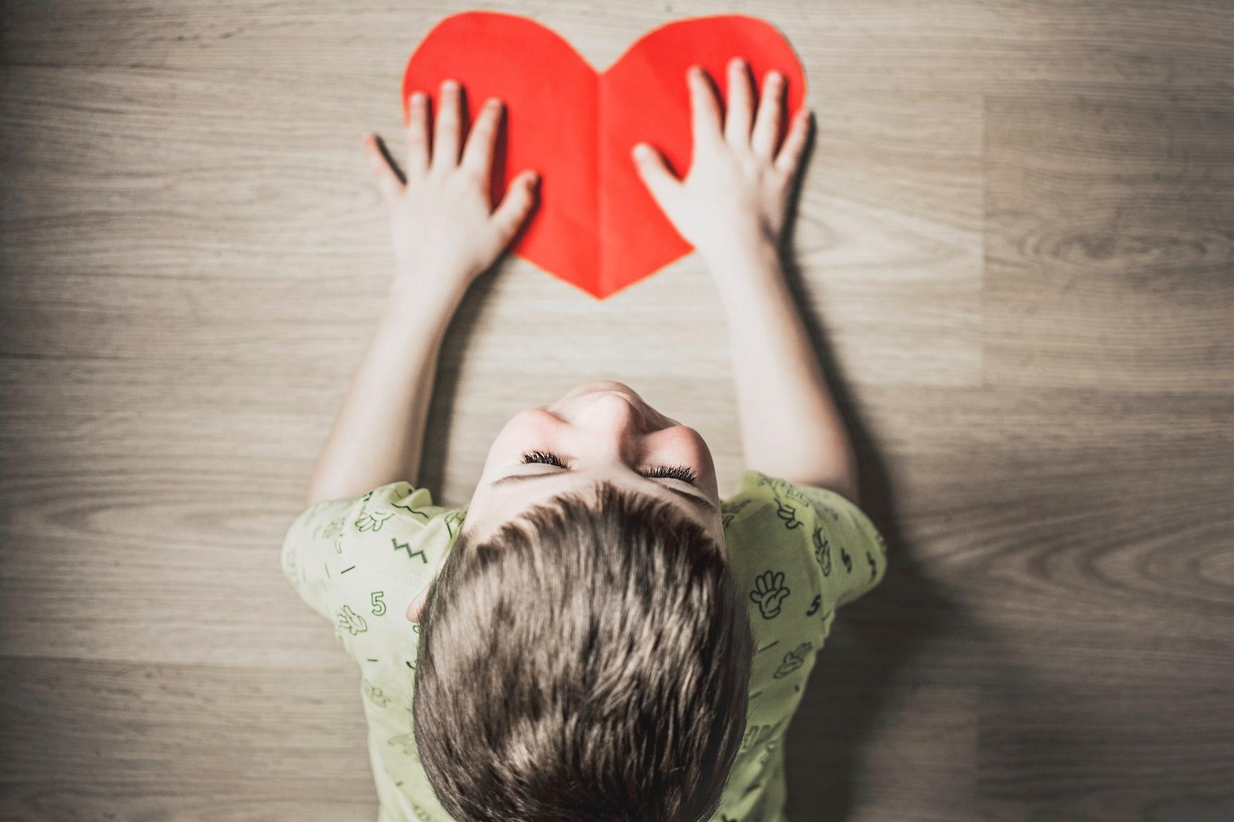boy holding craft red heart kid toddler
