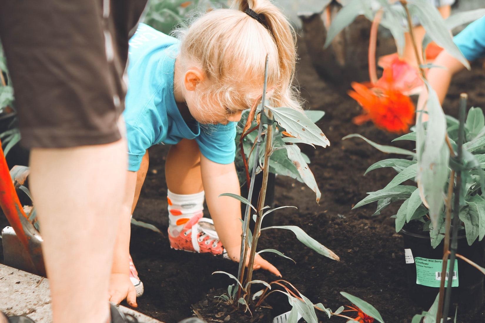 girl gardening planting flowers