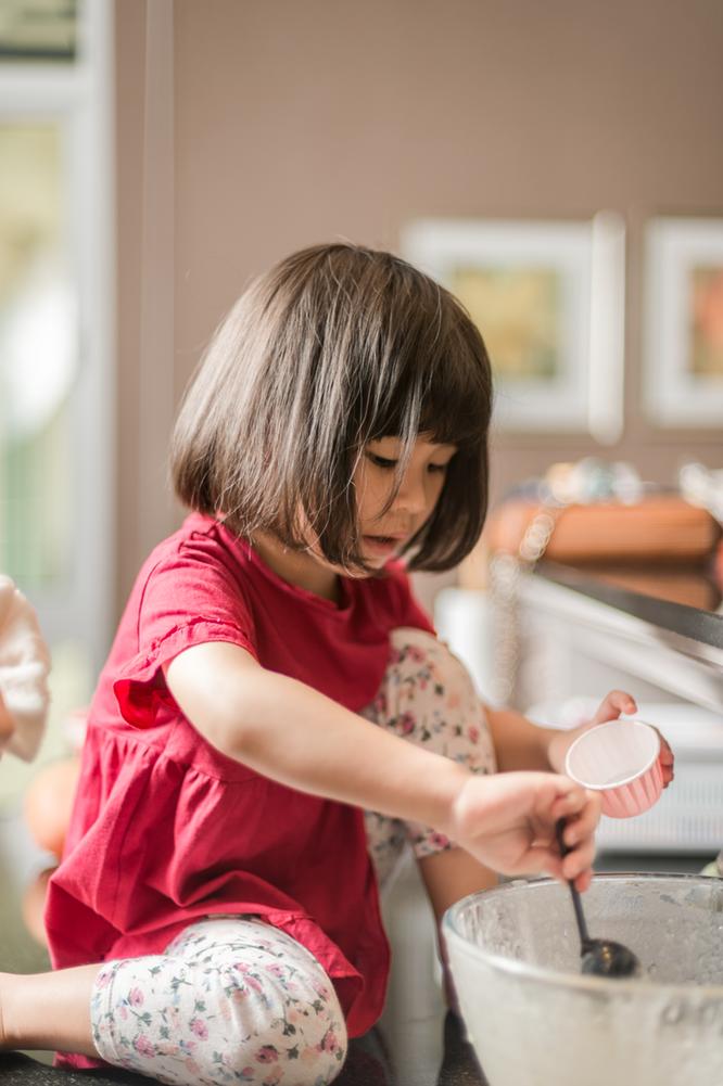 girl mixing baking in kitchen